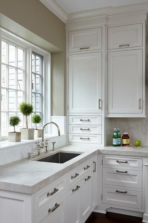 crisp white shaker cabinets go to the ceiling in this white kitchen and create a spacious feel on kitchen cabinets not white id=22287