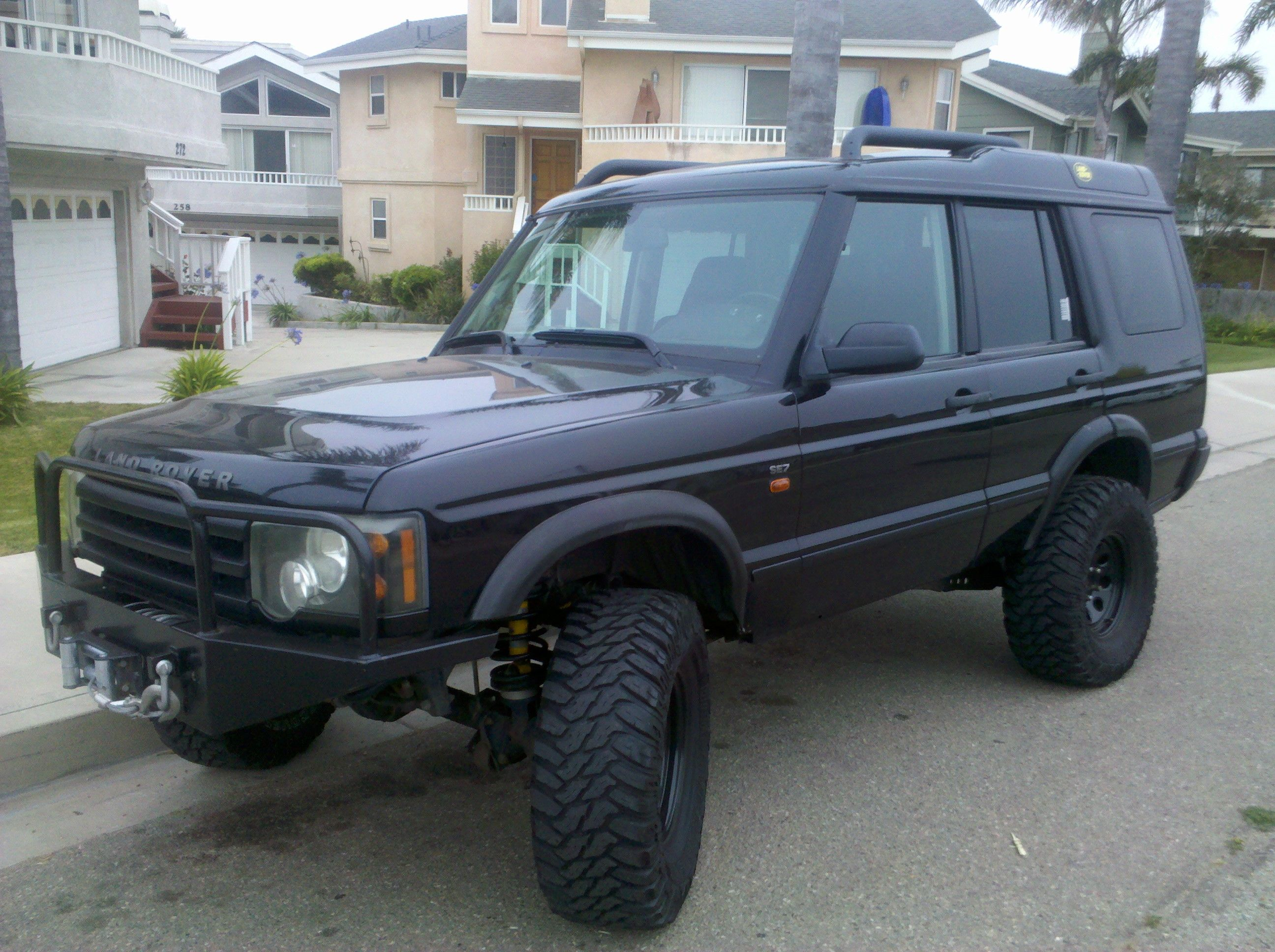 2004 Land Rover Discovery 2 with 6 inch lift custom bumpers rims