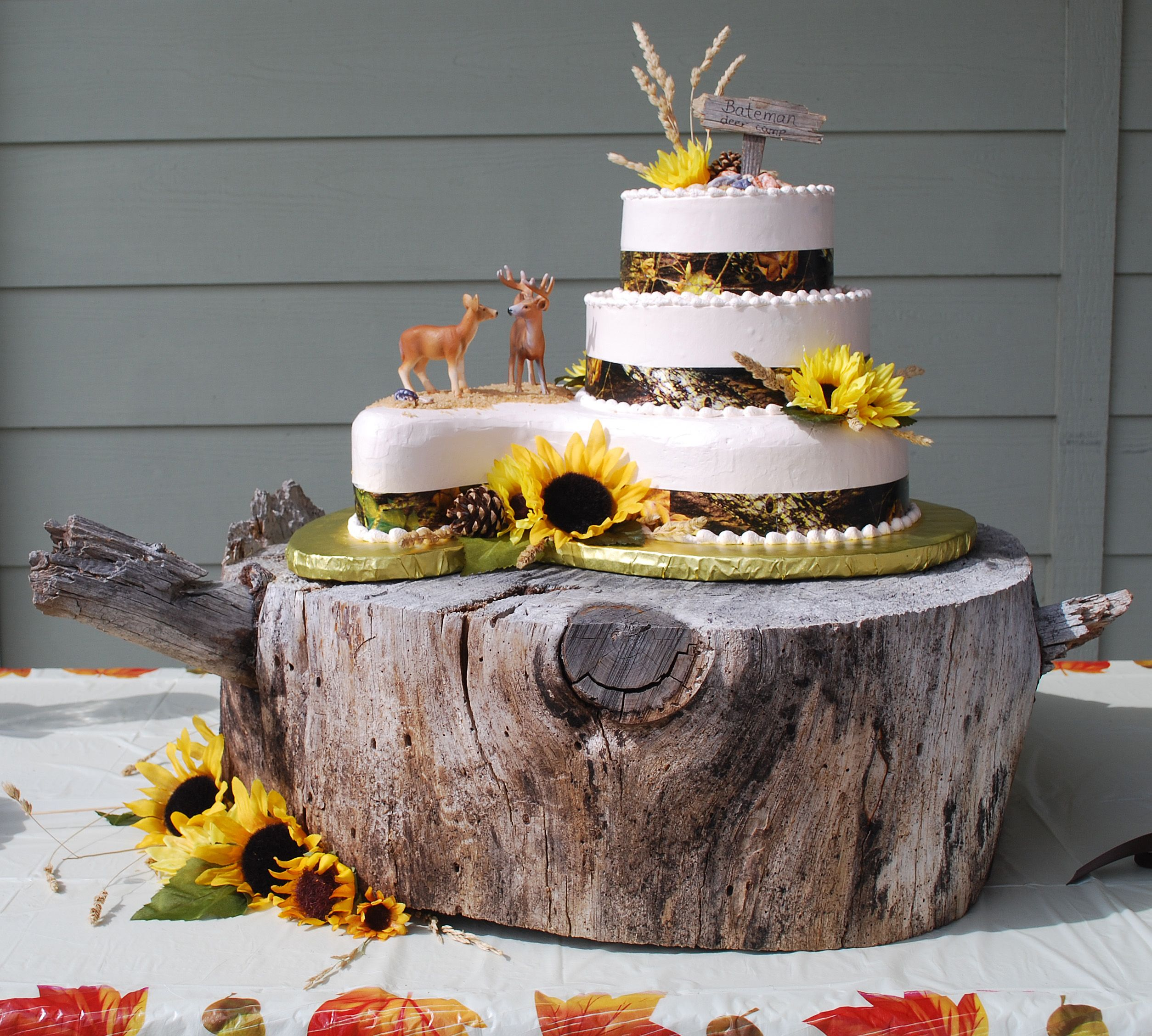 Camo Wedding Cake With Sunflowers And Rustic Wood Slab