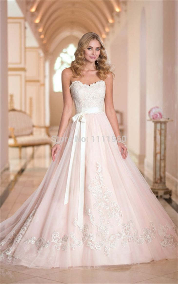 blush wedding dress with sleeves  how to dress for a wedding Check