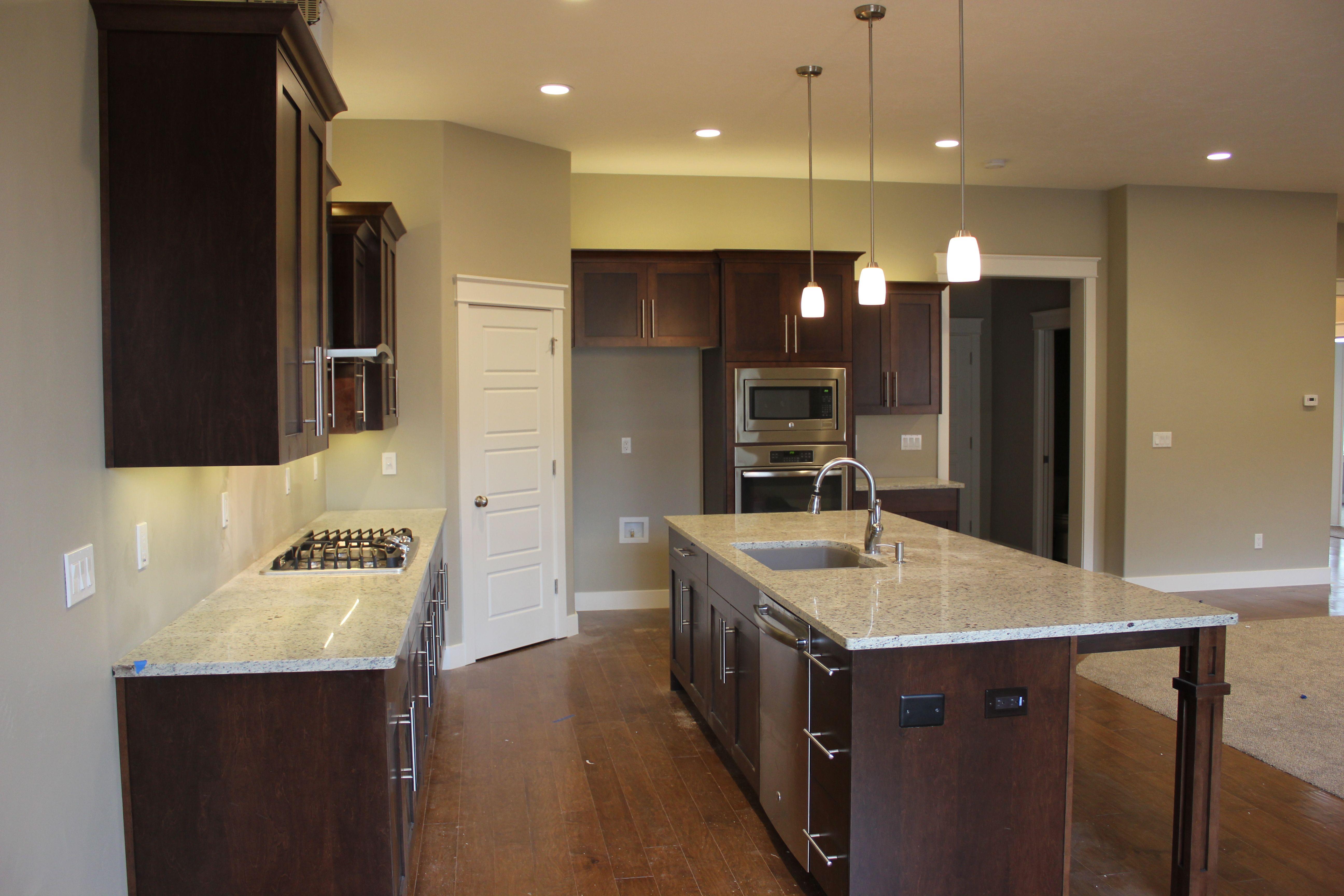 Dark maple cabinets with a light granite countertop ... on Maple Kitchen Cabinets With Granite Countertops  id=82467