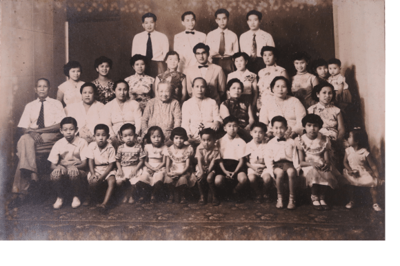 Again from the 1950s - my grandmother's entire family. Gran is on the right, second row. To the left are her mother (great-grandma) and her grandmother (great-GREAT-grandma!). My grandfather is up the back, 1st on the left. The children arrayed down the front are my father, and my multitudes of aunts and uncles! Peranakan families were never small! For special occasions like this, you'll see that some women still held the habit of wearing sarong-kebaya.