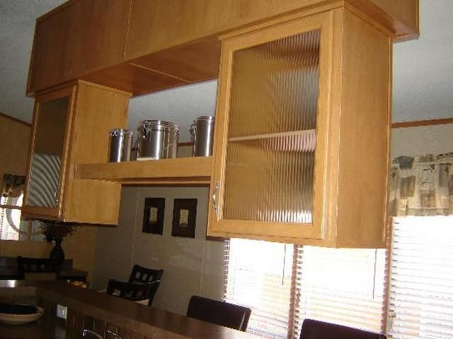 How to attach cabinets concrete wall for Attaching kitchen cabinets to wall