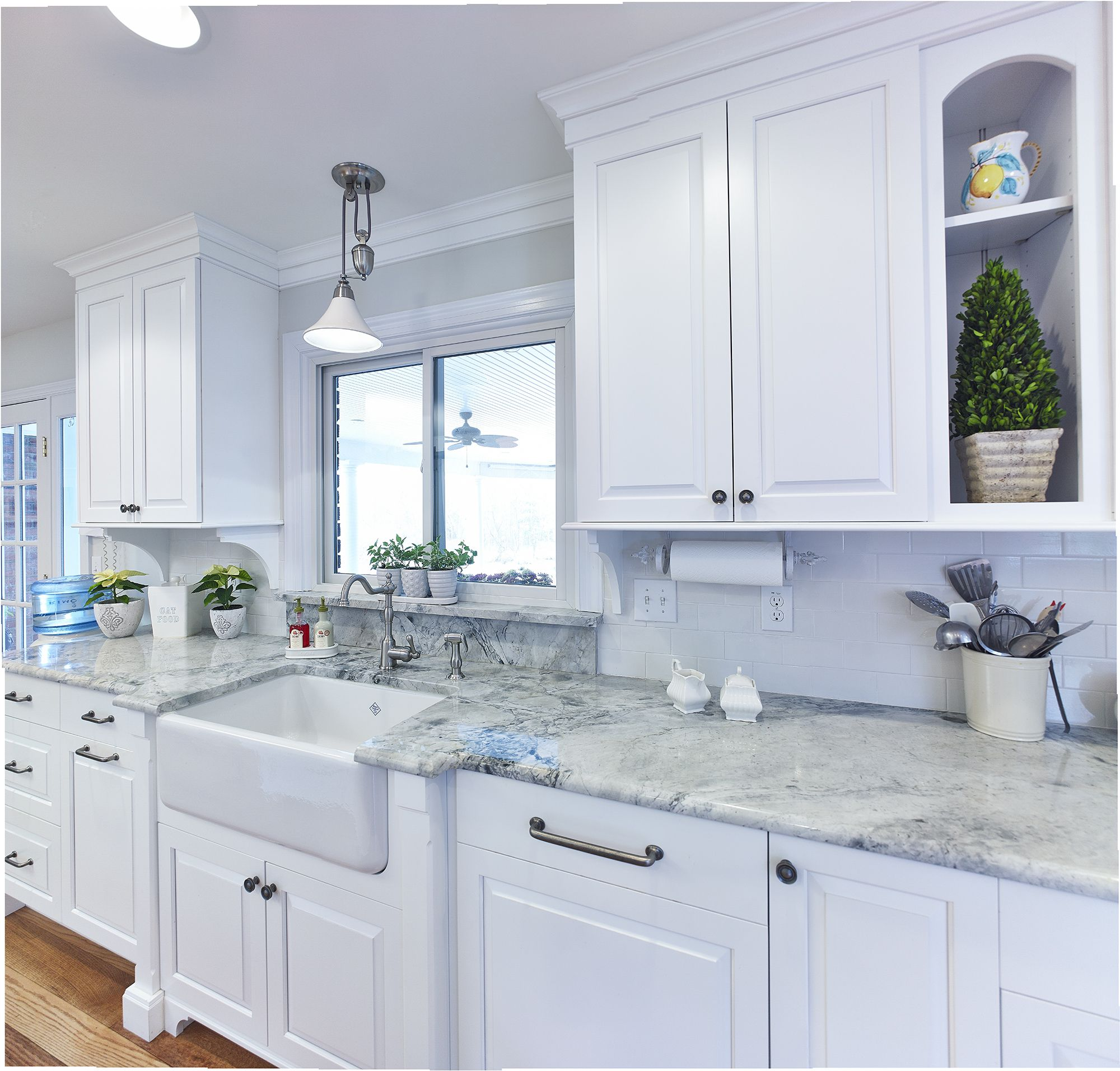 Custom white kitchen with farmhouse sink and super white ... on Kitchen Farmhouse Granite Countertops  id=12766