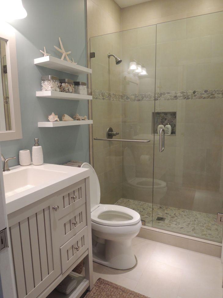Beach theme bathroom Stone shower floating shelves shell decor