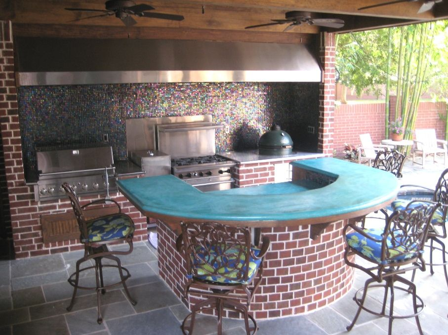 outdoor kitchen in the sugar land texas area with large vent hood concrete counters big green on outdoor kitchen ventilation id=37955