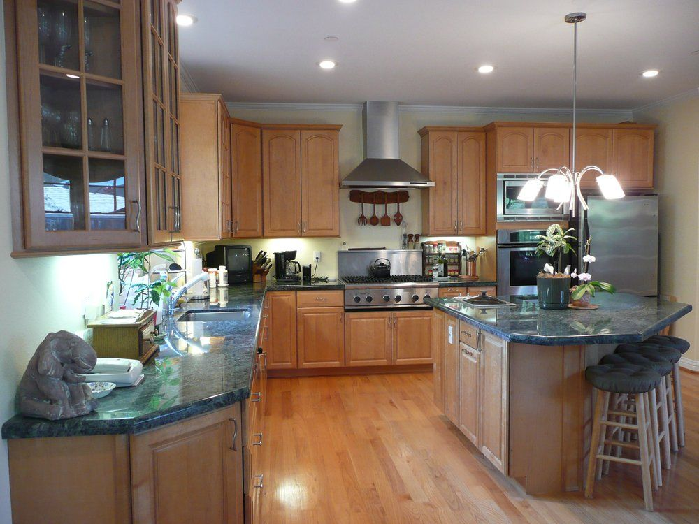Kitchen with maple cabinets, granite counter tops and red ... on Countertops With Maple Cabinets  id=32082