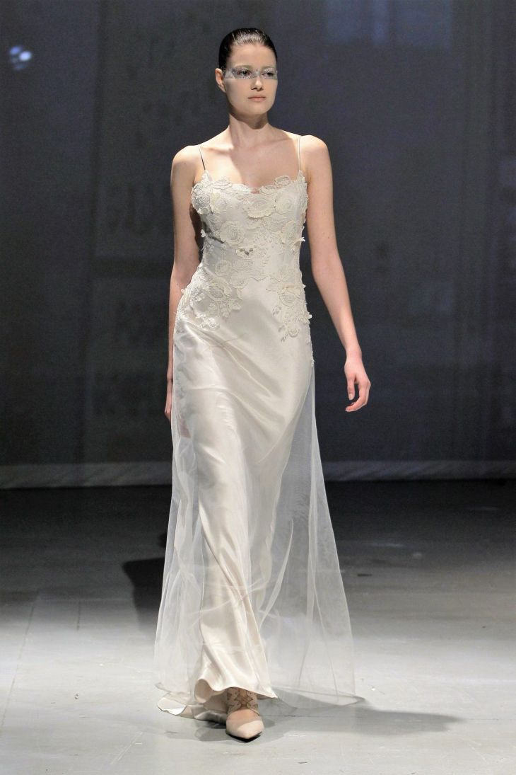 This sheath gown features a bateau neckline with a natural waist in