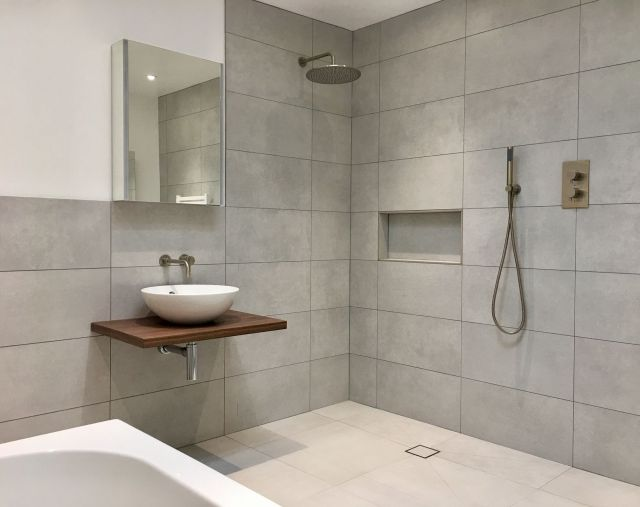 Vessel sink and built in recessed shower shelf in contemporary