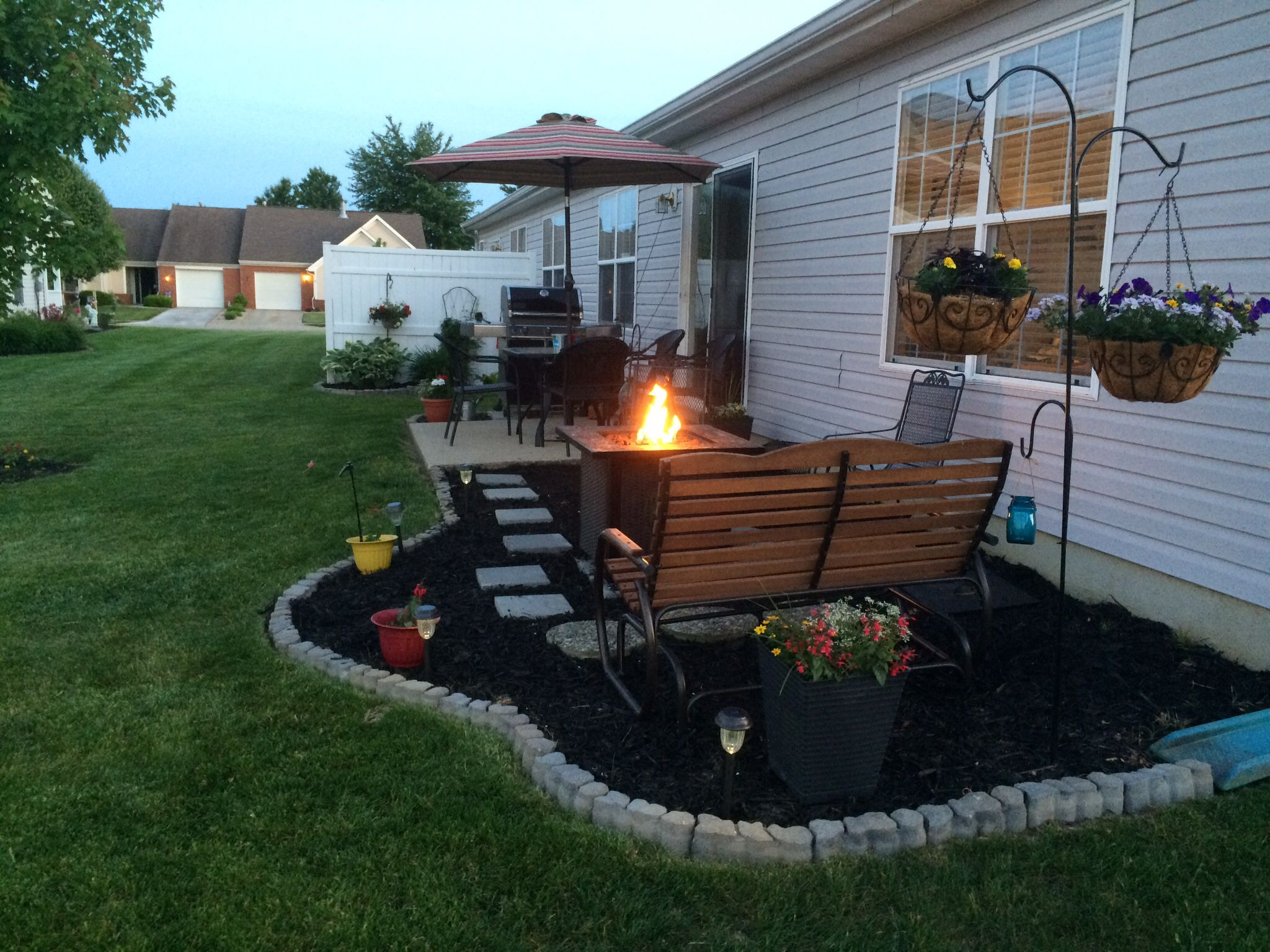 Low cost patio extension, using mulch, paver steps, and ... on Low Cost Backyard Patio Ideas id=68543