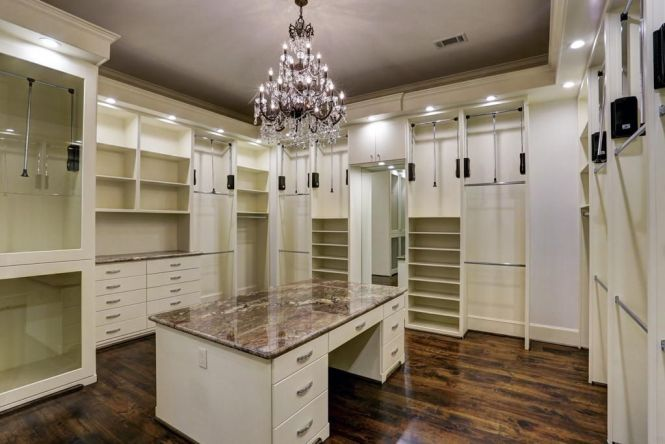 Master Walk In Closet With Seated Granite Countertop Ng Station Pull Downs And Chandelier