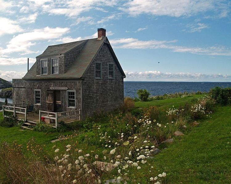 Image result for photo of a cottage by the sea