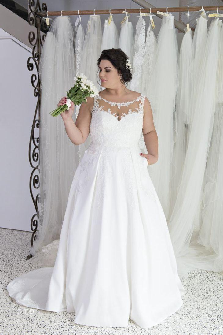 Plus size bride in Essense of Australia gown  size