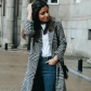 Comfy winter outfit wearing jeans sneakers and plaid coat style
