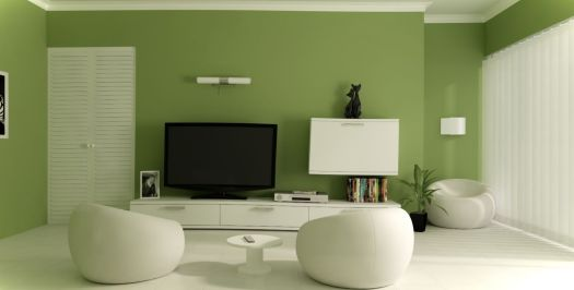 Beautiful Small Living Room Design With Green Wall Paint Color And Three White Ottoman Set Near