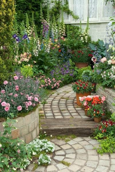 beautiful flower gardens pinterest Beautiful perennial flower garden with brick path - love