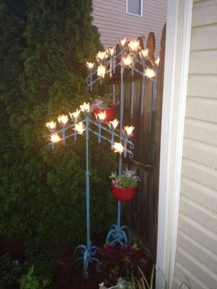 Old wedding candelabras painted blue Added lights and hanging