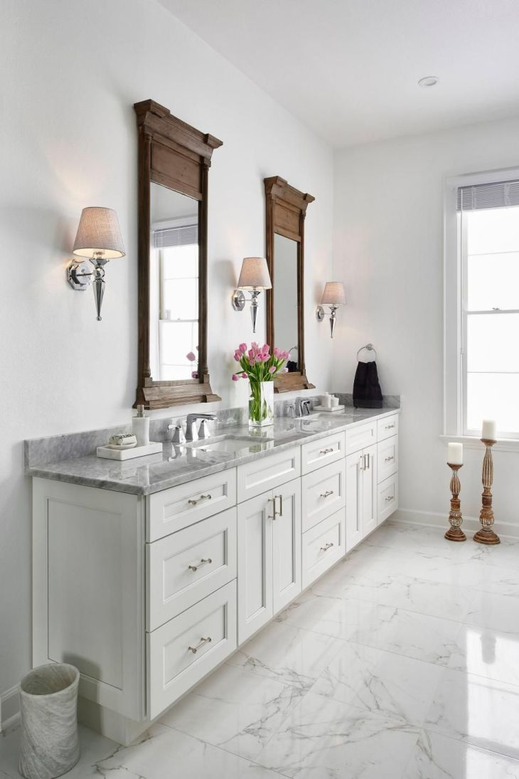This traditional white master bathroom features white Shakerstyle