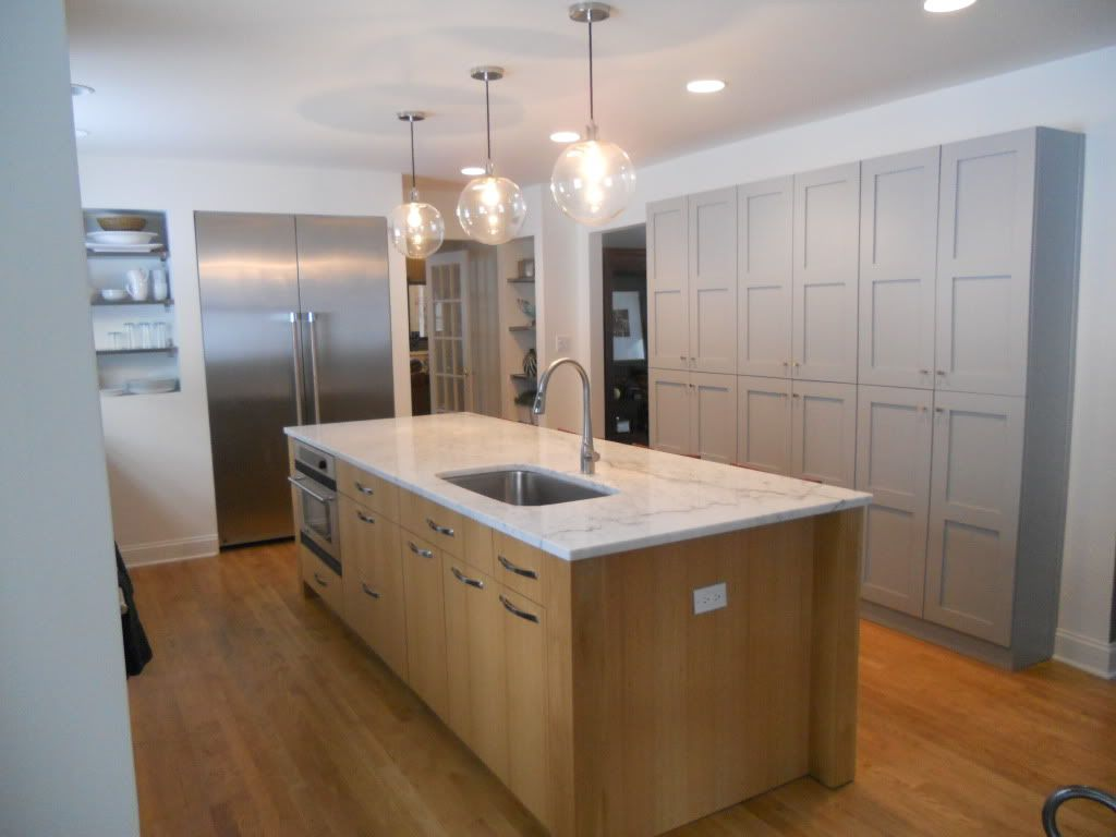 white countertop with wood base, contrasting with painted ... on Natural Maple Cabinets With Quartz Countertops  id=42159