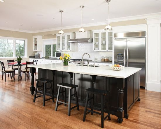 white kitchen cabinets black island black stools subway tiles taupe paint wall color island on kitchen island ideas black id=12994