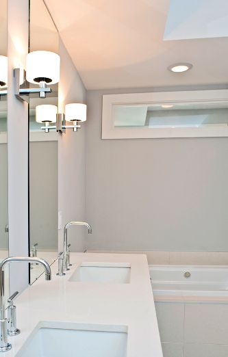 Transom Window Above Bathtub Area To Allow Natural Light Into A Bathroom Located In The Interior