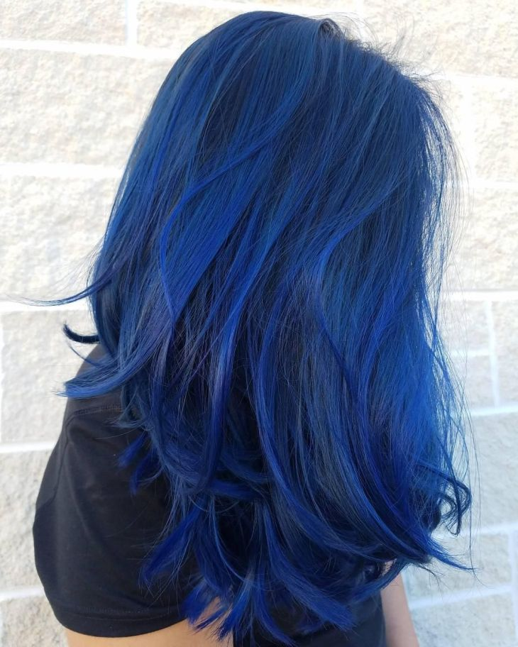 Amazing vibrant sapphire blue Aveda hair color by Aveda Artist