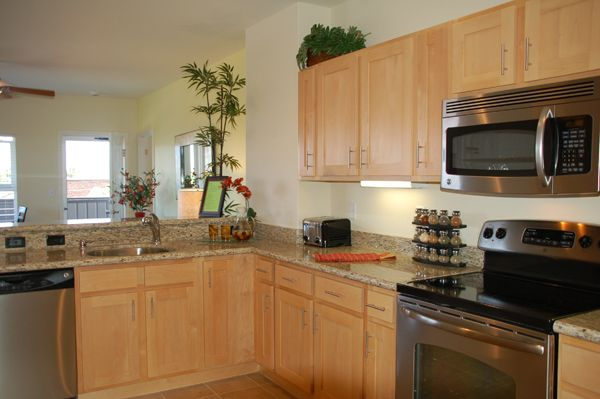 light colored oak cabinets with granite countertop ... on Natural Maple Cabinets With Black Granite Countertops  id=86998