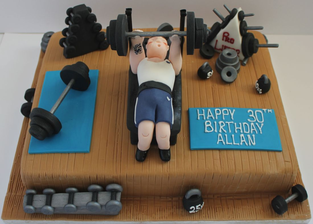 A cake for someone who loves the gym and lifting weights