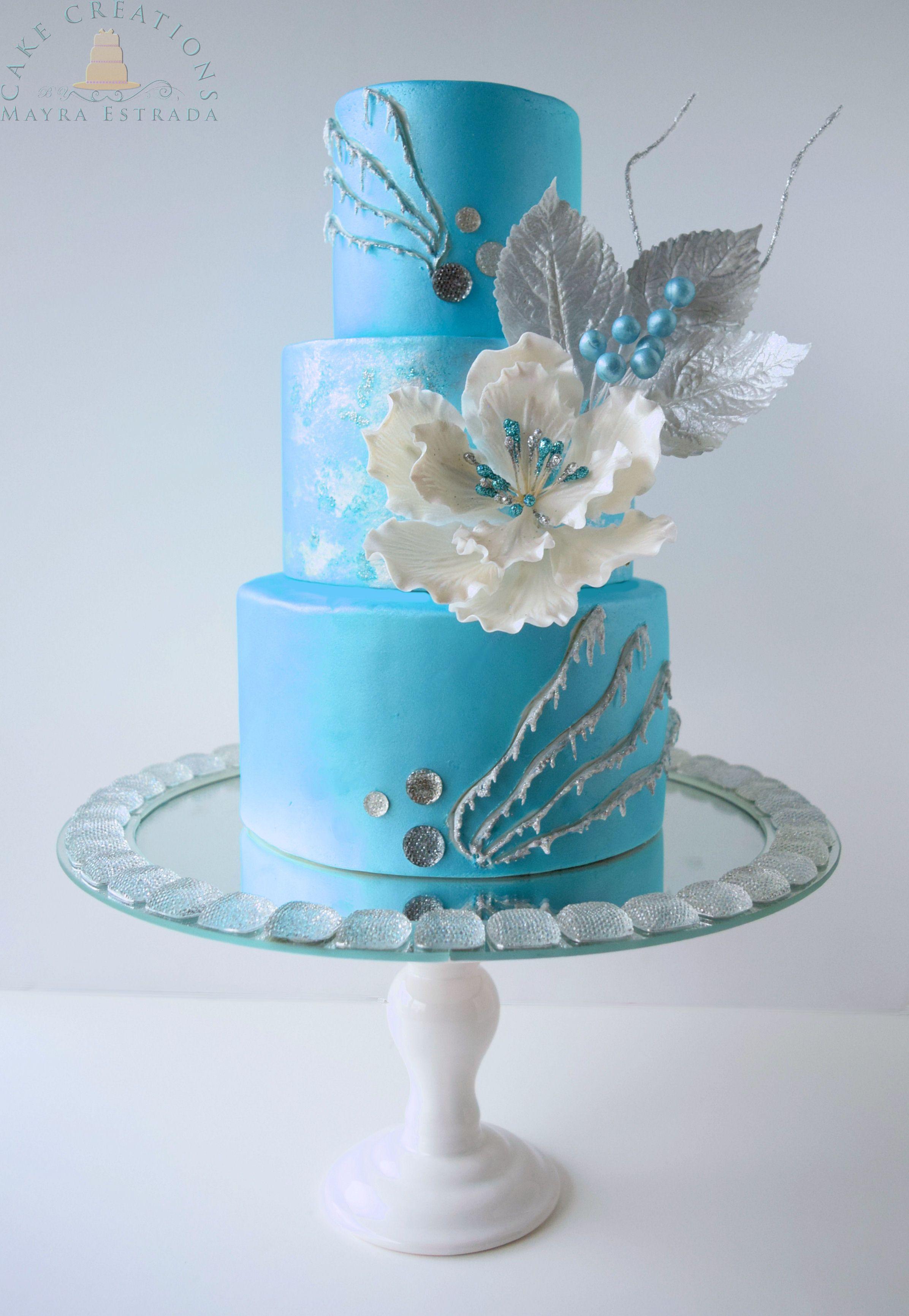 Sky Blue Wedding Cake With White Flowers