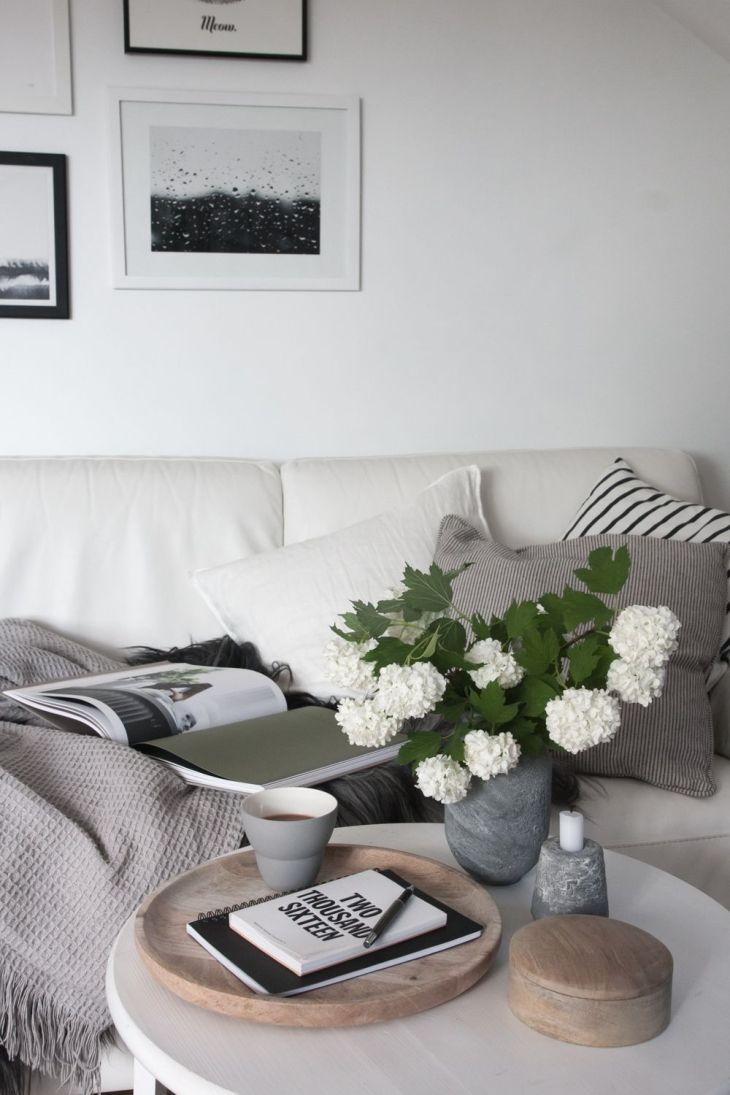 Scandinavian living room White and grey with a touch of wood and