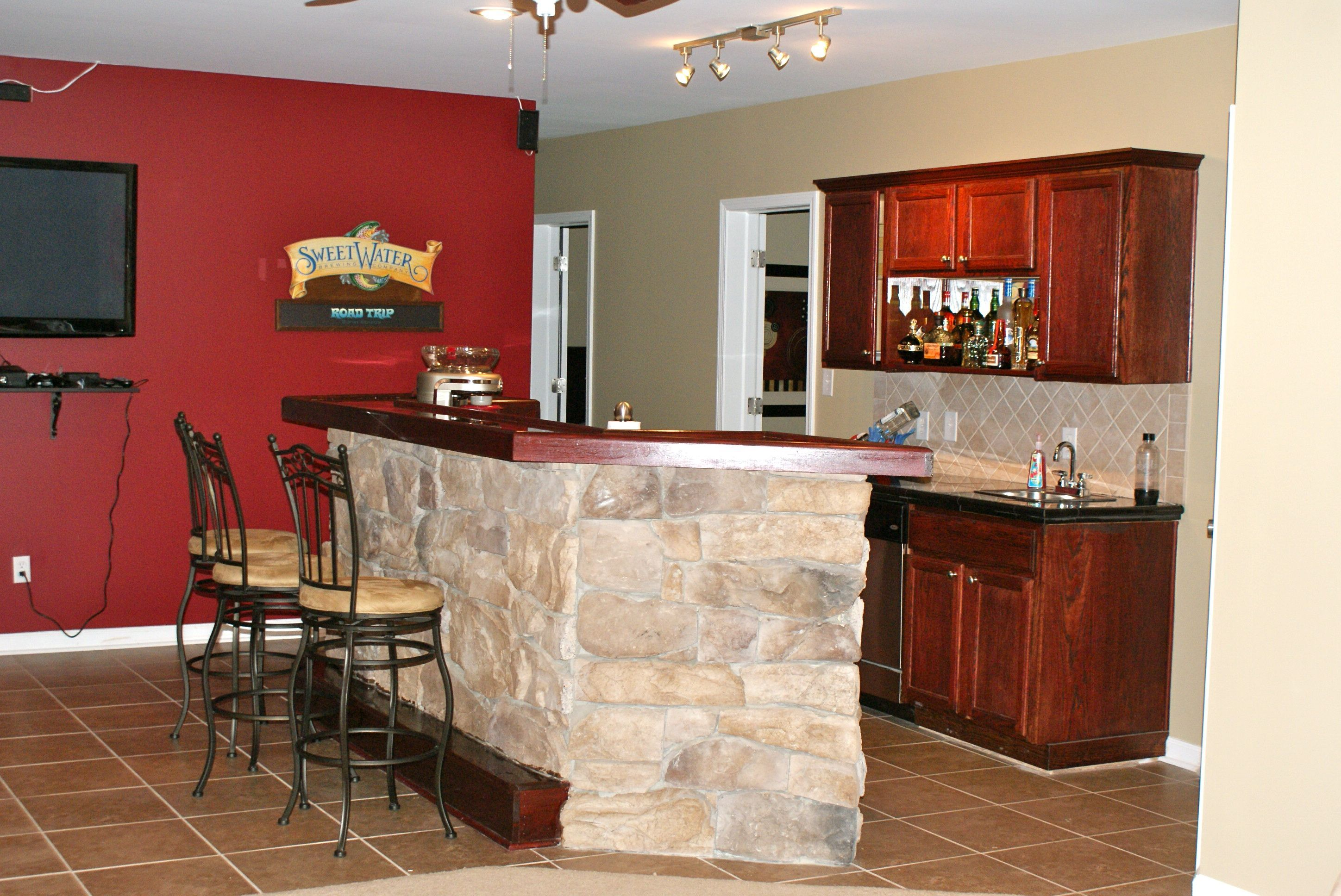 Red Wall And Stone Bar Counter Also Wood Bar Cabinet And