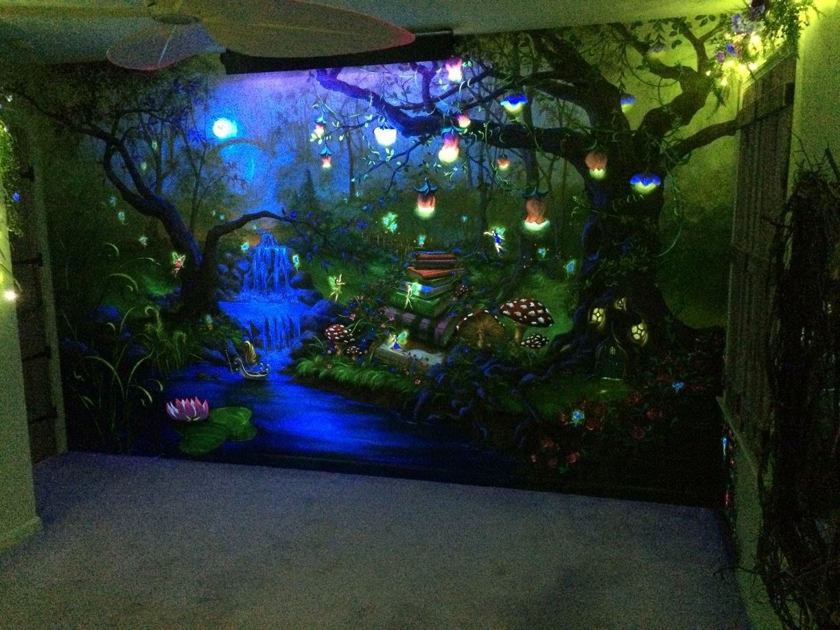 enchanted forest bedroom mural under the blacklight - at night