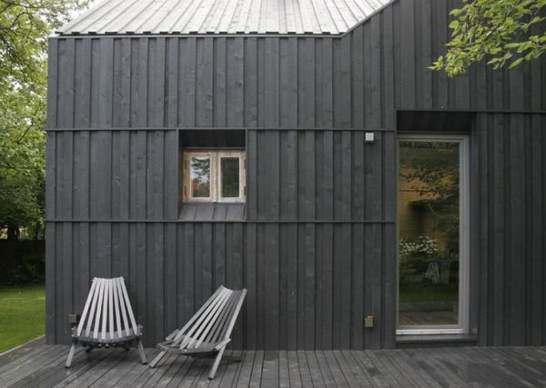 black stained sheds This charcoal stained timber clad