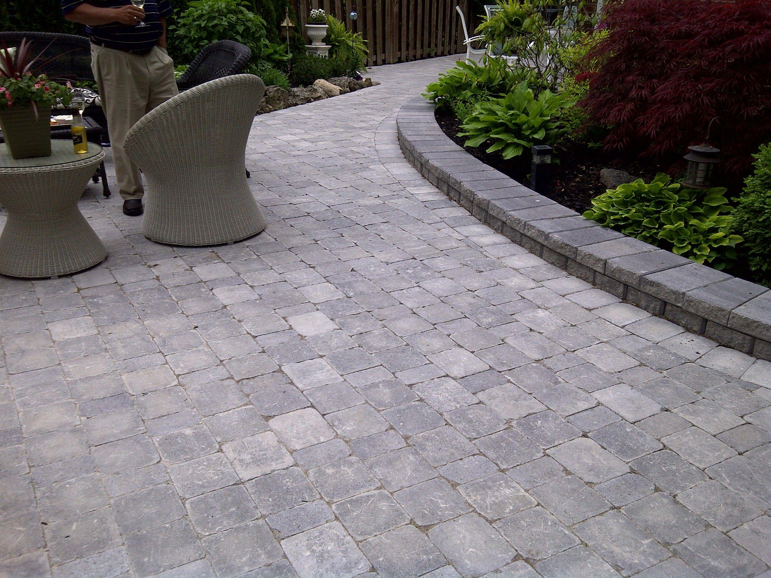 Interlocking stone patio using Brussels block Unilock ... on Unilock Patio Ideas id=52691