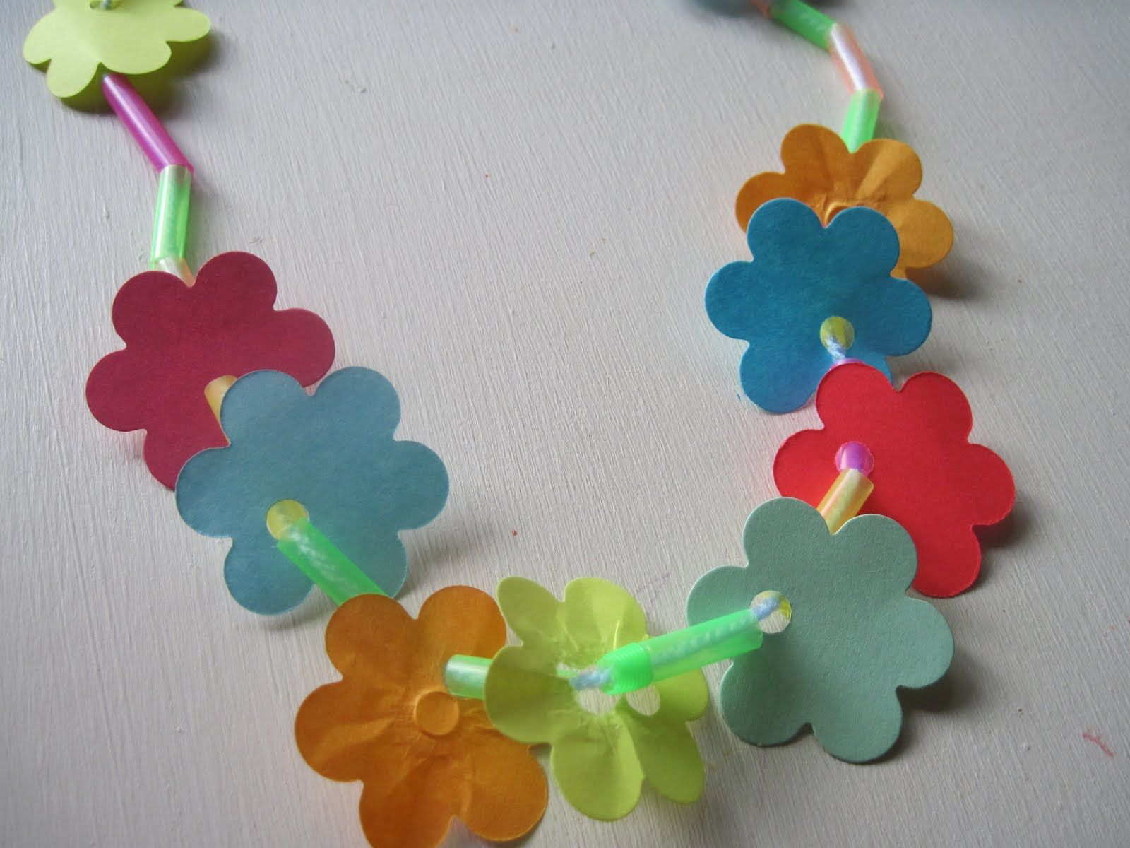 Make A Lei Using Recycled Paper Scraps Straws And Yarn