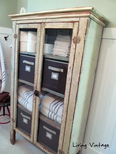 old chippy cabinet we use for bathroom storage - living vintage
