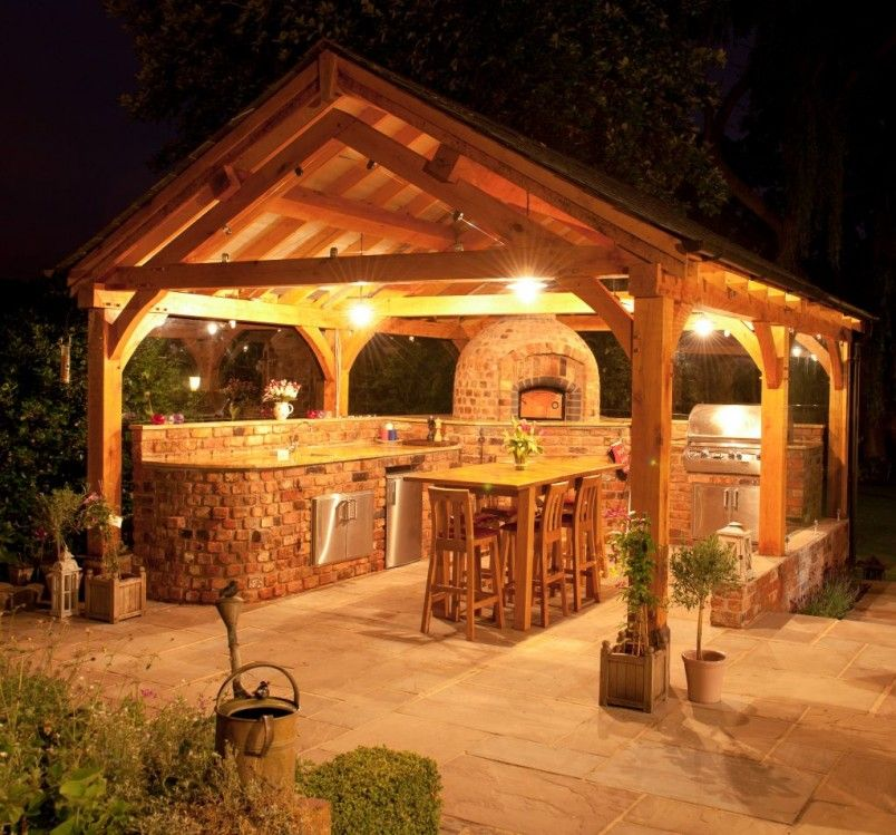 romantic outdoor kitchens ideas in wooden gazebo at night with lovely lights and rustic brick on outdoor kitchen gazebo ideas id=47235