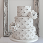 Elegant silver scalloped wedding cake by sugar ruffles weddingcake