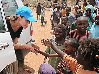 Image result for angelina and brad in africa