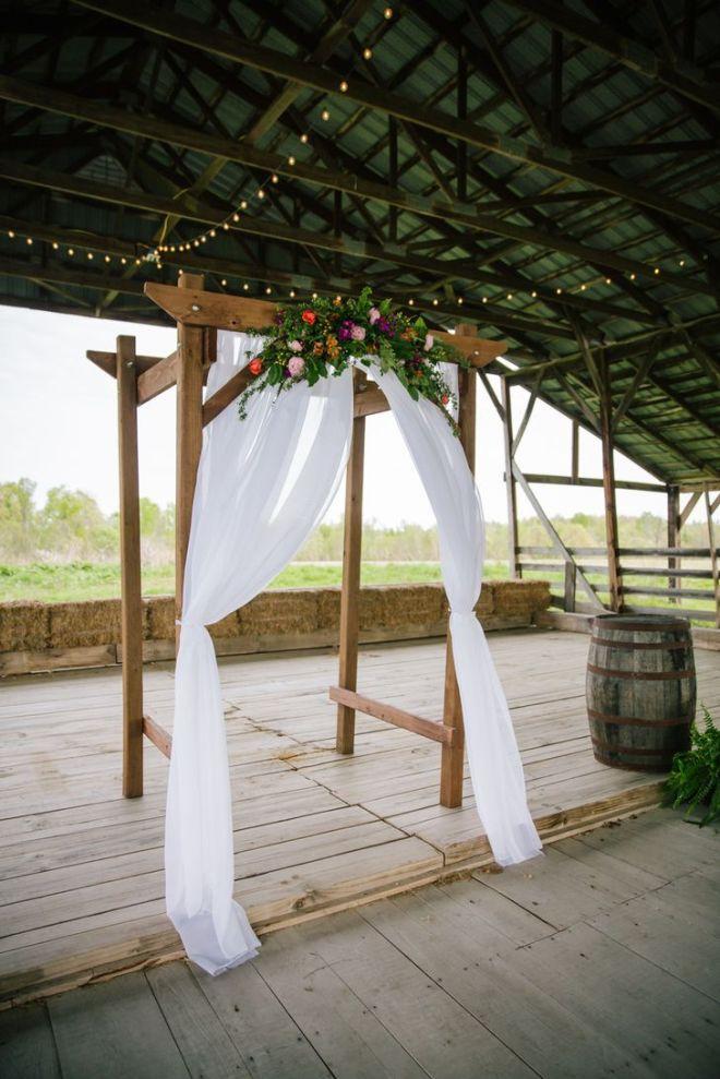 Diy wooden wedding arch with colorful flowers burdoc