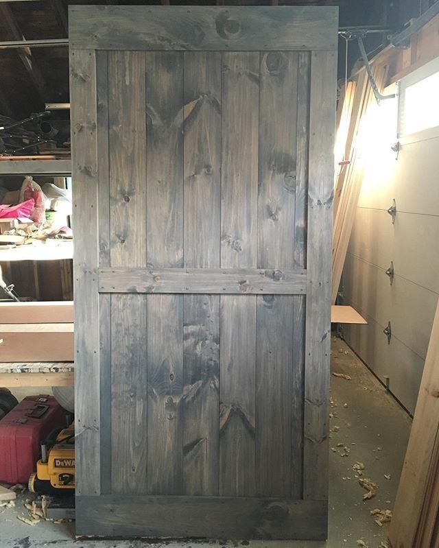 a mid bar with border barn door in minwax classic grey on Rustic Gray Barn Door id=81449