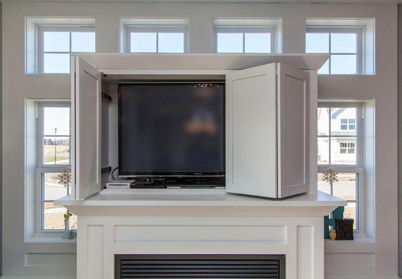 Fold Back Doors To Hide Tv White Trimwork Bella Homes