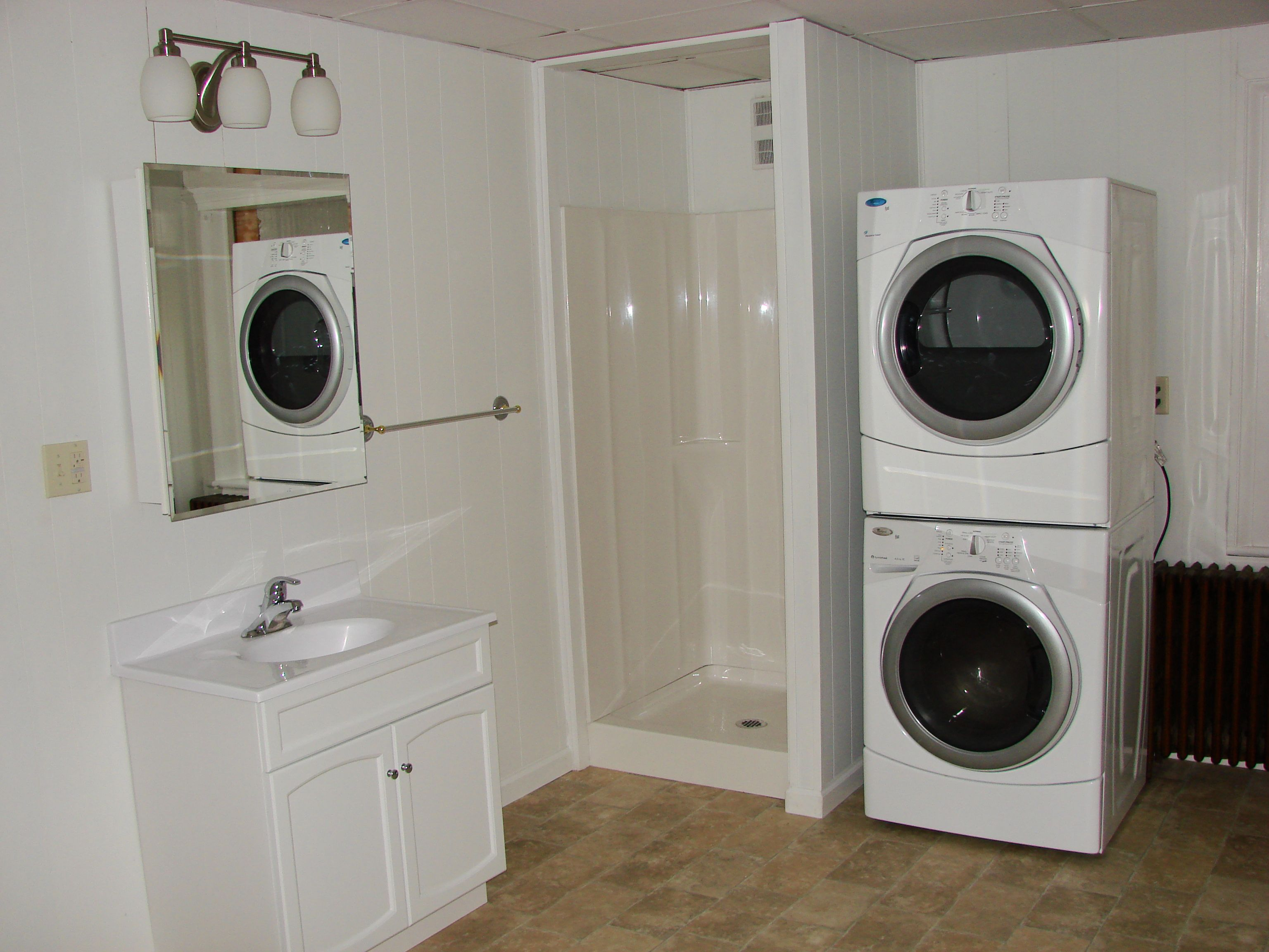 Cool White Wash Machine And Dry Machine On The Side Of ... on Small Space Small Bathroom Ideas With Washing Machine id=44519