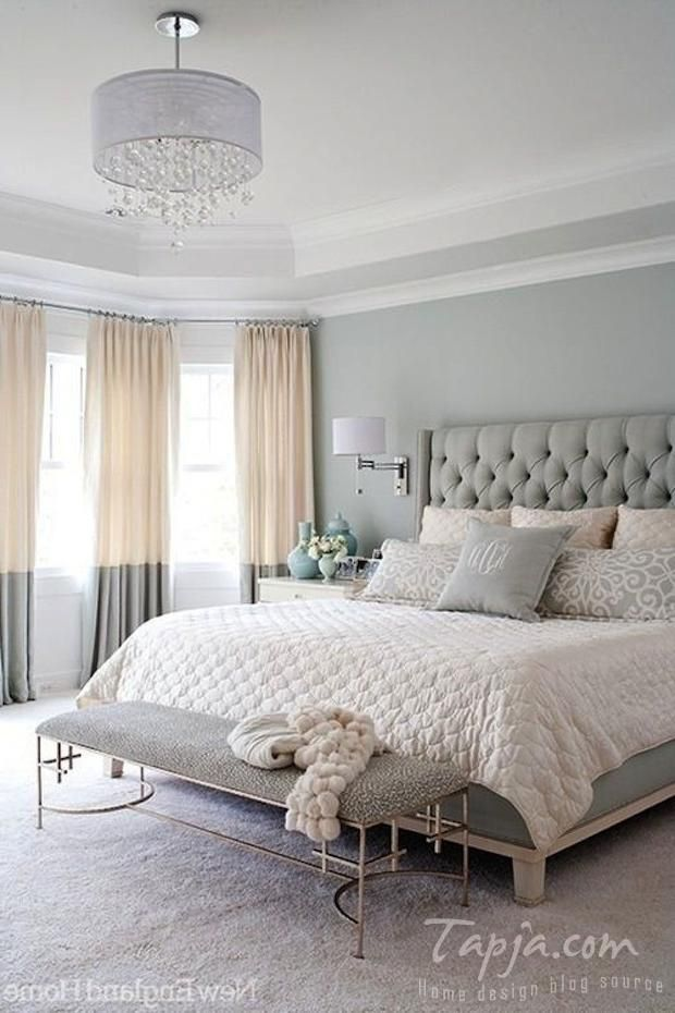 master bedroom with pastel color grey color plus bedroom bench and