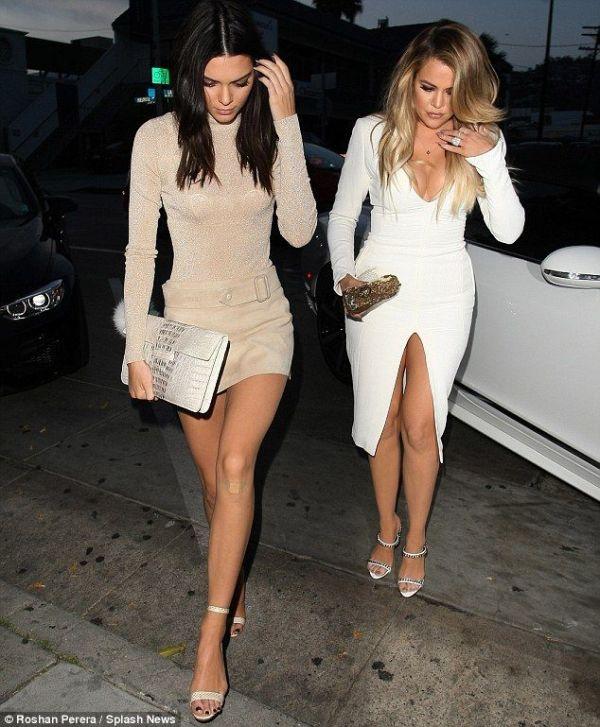 Khloe Kardashian dons body hugging white dress for family ...