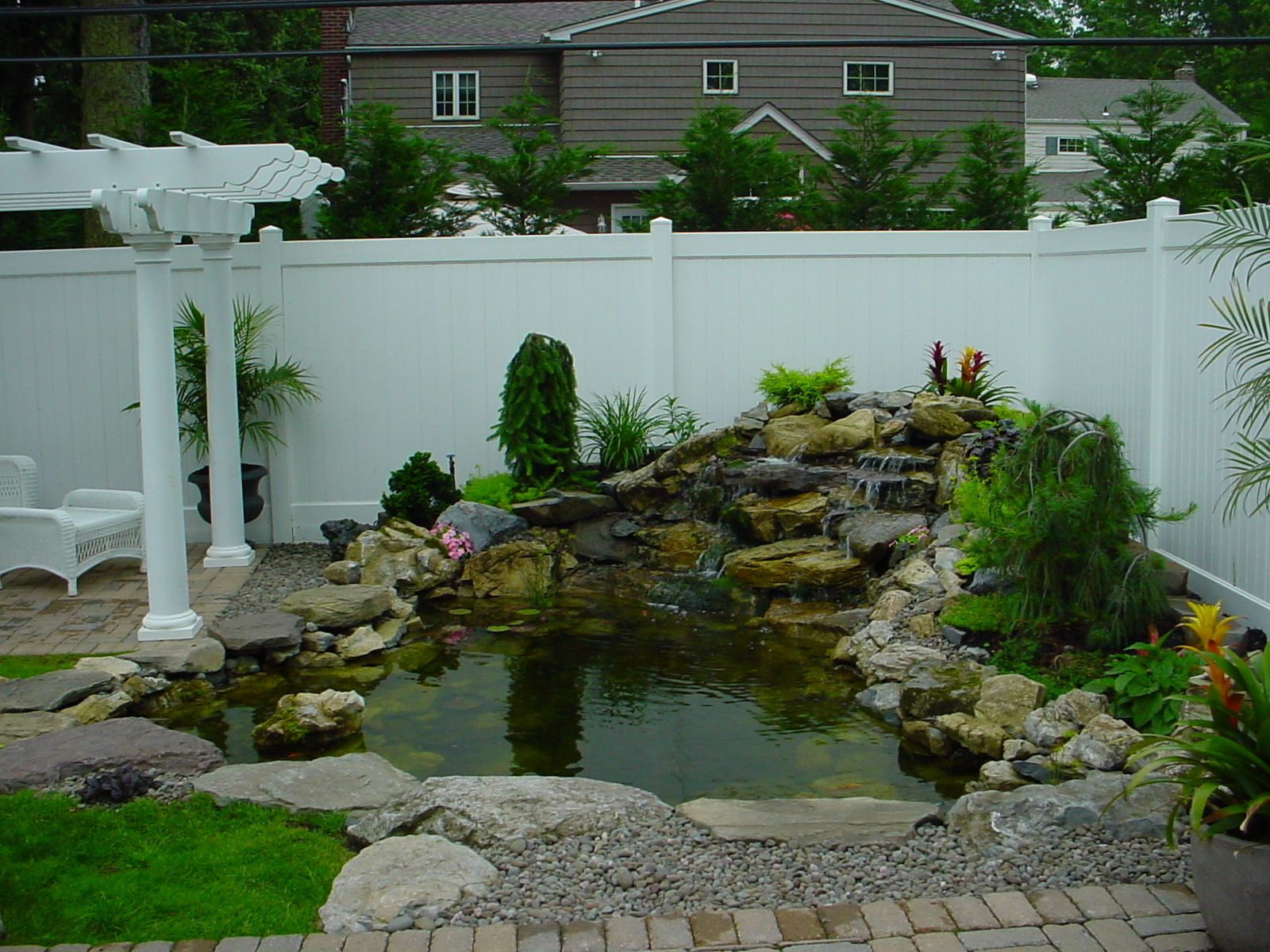Small Backyard Ponds and Waterfalls | call for free ... on Small Backyard Pond With Waterfall id=70224