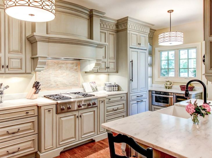 CraveWorthy Kitchen Cabinets Marble countertops Raised panel and