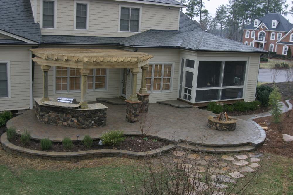 Like the raised patio with plantings - Triangle Co | Patio ... on Raised Concrete Patio Ideas id=31110