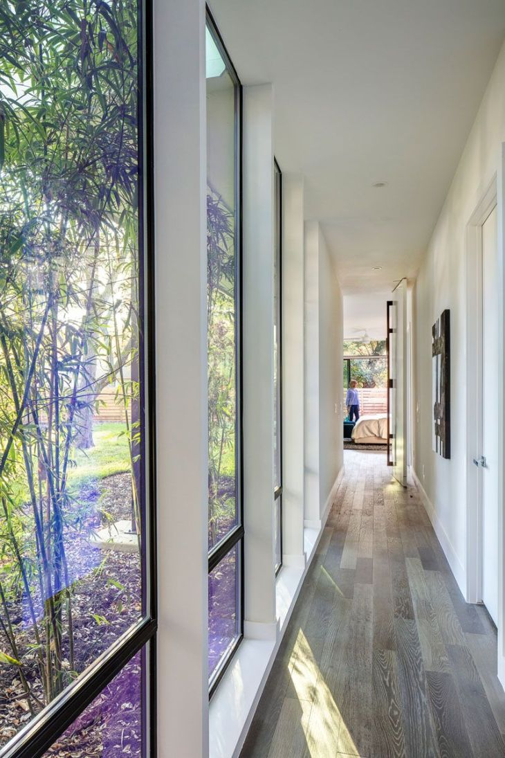This modern hallway with floortoceiling windows connects the