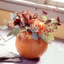 pumpkin with flower arrangement. Now i just need an easy way of scraping out the insides! http://www.decor4all.com/22-simple-fall-craft-ideas-diy-fall-decorations/17104/